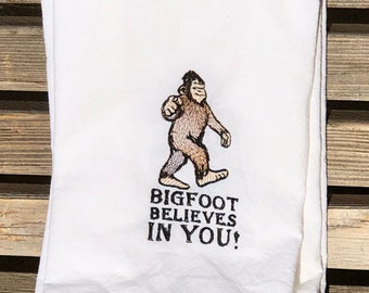 Bigfoot believes in you is embroidered on a white flour sack tea towel, dish towel, cotton