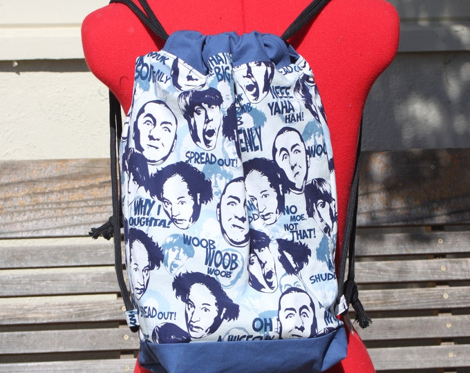 Featured listing image: 3 Stooges, Larry Moe and Curly Drawstring backpack, a fun accessory for any outfit, Canvas lined and bottom for durability, inside pocket