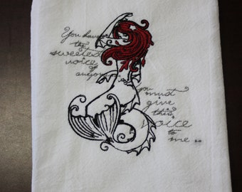A Beautifully drawn stylized Little mermaid is embroidered on a white flour sack tea towel, dish towel, cotton