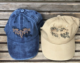 A Stylized bat is  Embroidered on a Baseball Hat Cap, Adjustable hat, adult, dad hat, trucker hat