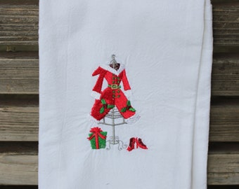 Mrs Claus outfit is hanging ready for her is embroidered on a white flour sack tea towel, dish towel, cotton
