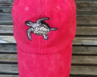 A sea turtle is  Embroidered on a Baseball trucker dad Hat Cap, Adjustable hat, adult