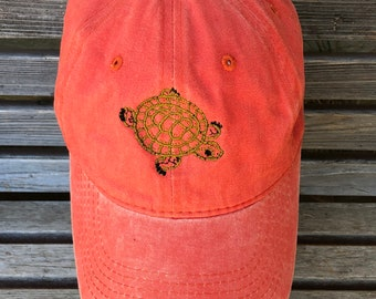 A turtle outline is  Embroidered on a Baseball Hat Cap, Adjustable hat, adult, dad hat, trucker hat