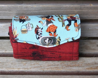 cowgirl, retro mini-wallet, based on the NCW pattern, Accordian wallet. Lots of places for necessities, removable crossbody and wrist strap