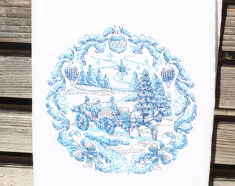 A Beautiful Christmas delft blue is embroidered on a white flour sack tea towel, dish towel, cotton