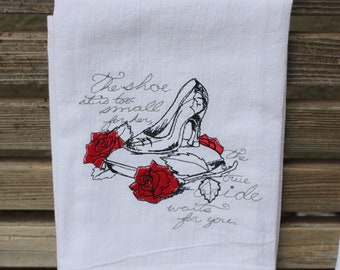 A Beautifully drawn stylized Cinderella glass slipper is embroidered on a white flour sack tea towel, dish towel, cotton