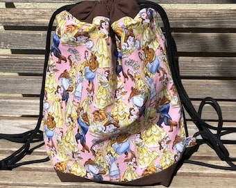 Disney Beauty and the Beast Drawstring backpack, a fun accessory for any outfit, Canvas lined and bottom for durability, pocket