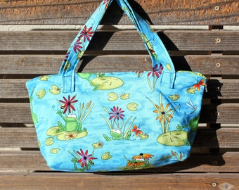 Happy playing frogs, vinyl lined bag, perfect for snack or lunch, cosmetics, makeup or even as a unique purse   Use as a fun gift bag,