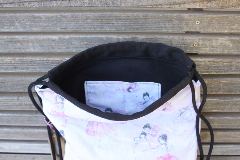 Canvas lined and bottom for durability a fun accessory for any outfit inside pocket Ballerina Dancers Drawstring backpack