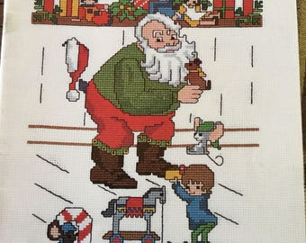 Children count on Christmastime cross stitch pattern book