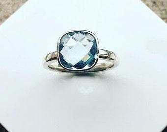 Silver Ring set with a 10mm Cushion Cut Blue Topaz