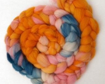 Naturally dyed hand painted merino braid, organic merino roving 'Happy go lucky'