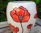 Hand drawn vase with illustration of poppies