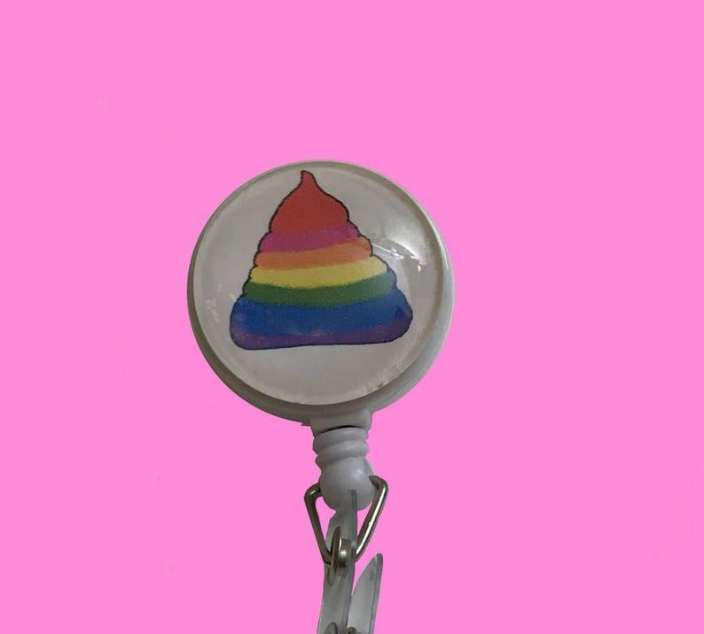 Unicorn Rainbow Poo Badge Reel Holder on alligator swivel clip