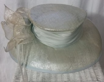 1990s Silk and Metallic Silver Hat by Nordstrom with Silk Ribbon finishing  in a pale silvery baby blue and straw flower on side. d931cd72624
