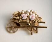 Vintage costume wheelbarrow brooch, golden rose pearl flower estate pin jewellery, garden retro badge jewelry, Valentines gift idea woman