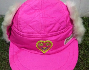 4c9b8725655 Rare Vintage Ellesse Cap With Earing Cover