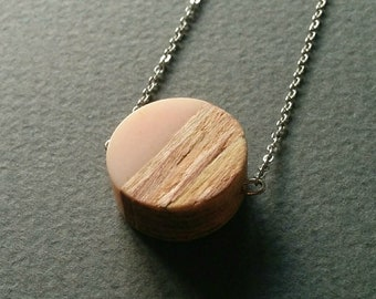 Pink resin and natural wood one of a kind handmade round pendant on a dainty stainless steel chain.
