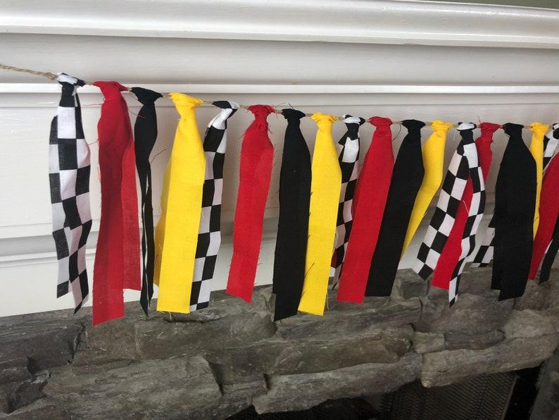 race car party*race car birthday*lightning mcqueen birthday*lightning mcqueen*checkered flag*racing party*race car birthday decorations