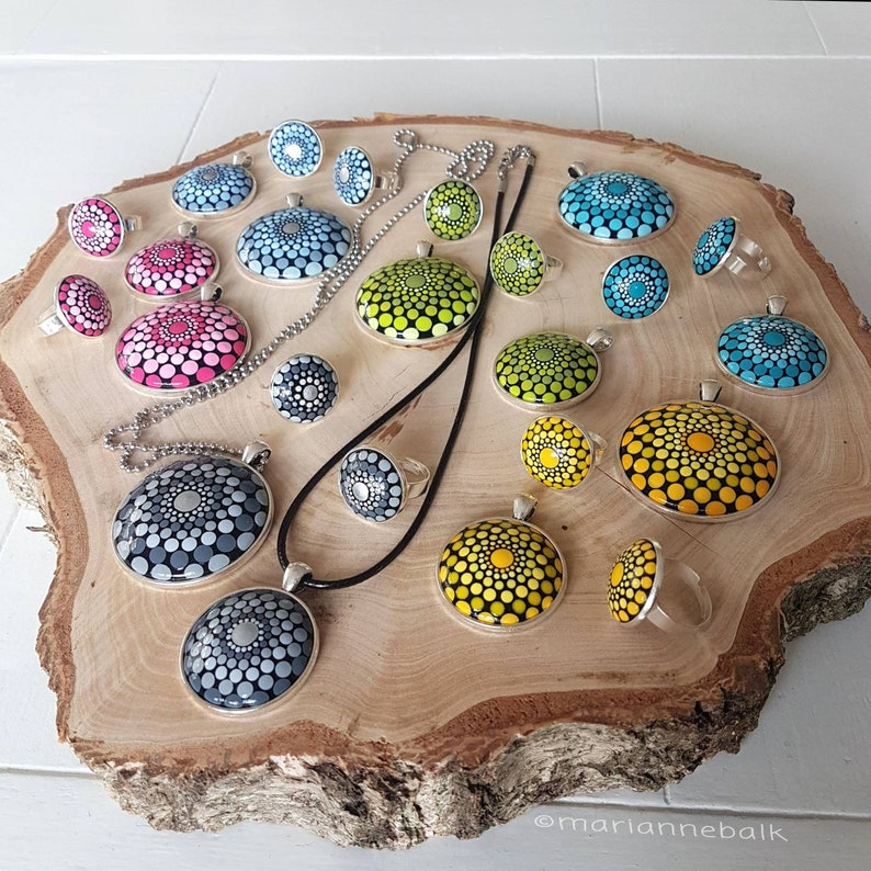 Dotpainted pendants in two sizes and a matching ring.