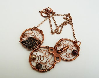 Copper 3 circle hammered and embellished with charms and bead pendant