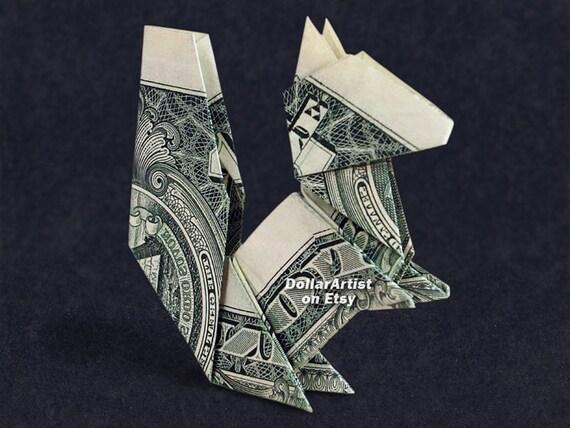 Geld Origami TURTLE gefaltet mit Real One Dollar Bill isoliert auf ... | 428x570