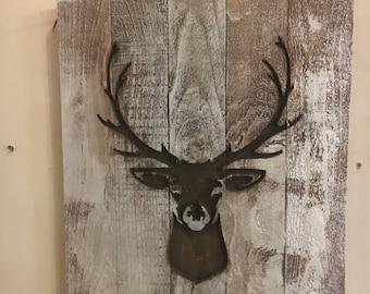 Deer Head silhouette carved in  wood