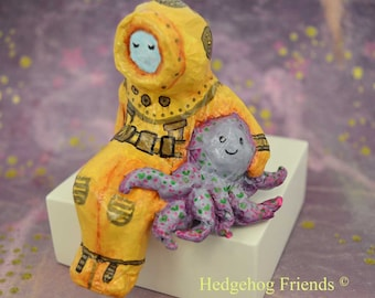 Decorative, whimsical paper mache diver and octopus