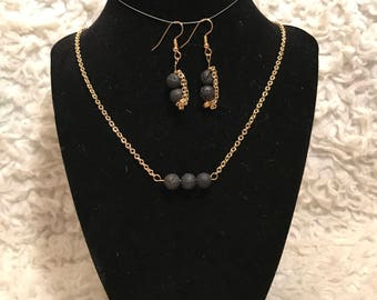 Gold Necklace and earrings with Black Lava Rocks