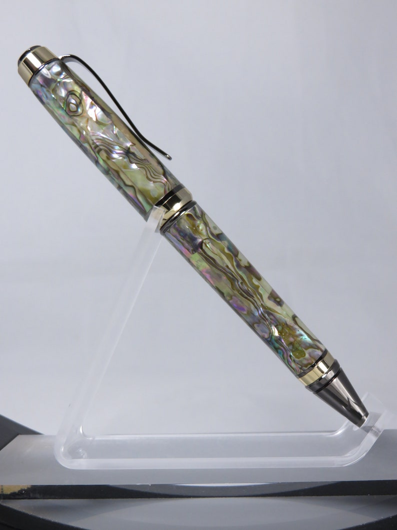 Cigar style in mother of pearl with goldgun metal hardware finishes Ballpoint twist pen my Item 102542
