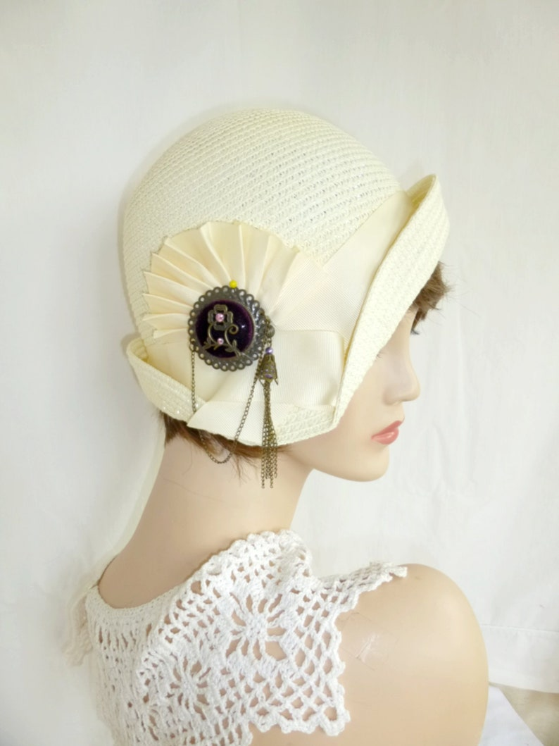 1920s Accessories: Feather Boas, Cigarette Holders, Flasks Cream Straw flapper Gatsby summer cloche with ivory trim Downton Abbey hat Miss Fisher cloche $99.00 AT vintagedancer.com