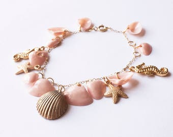 Bracelet with pendants. Sicily collection. Sicilian sea shells pink powder and golden. Souvenir of Sicily for Sea theme party.
