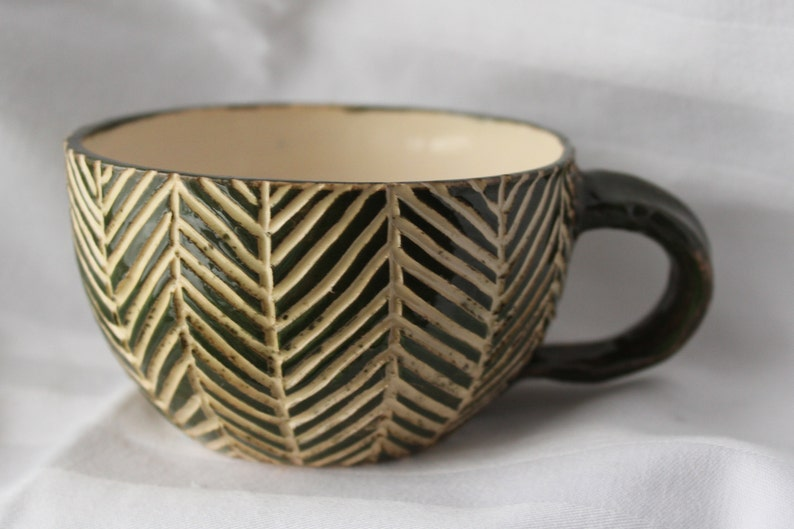 Handmade Pottery Mug With Abstract Carved Palm Leaf Texture