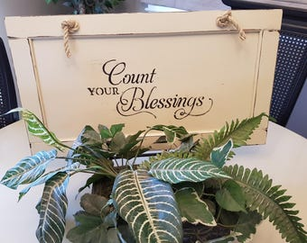 Count Your Blessings Farmhouse Look Word Sign on Cupboard Door