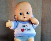 Vintage Uneea Kewpie Doll 70947 Little Boy Sitting in His Wicker Chair. 8 1 2 quot Tall