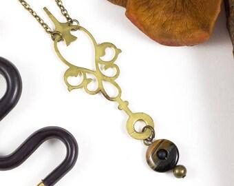 """Colgante oro viejo """"Oldies"""" con partes de relojes y un toque vintage"""