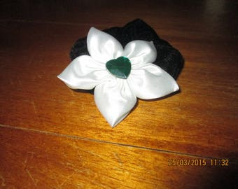 Darling velvet adorned with a white satin flower