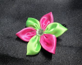 With a satin flower Barrette neon green and pink