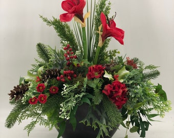 Artificial Red centerpiece! Lasts forever and looks nearly natural, red winter floral arrangement
