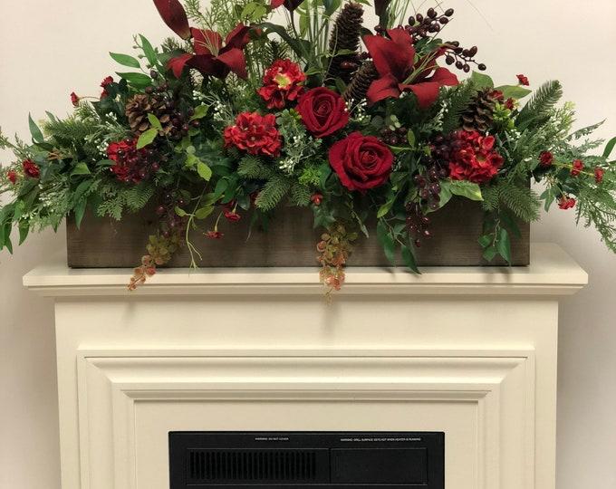 Artificial red centerpiece , mantel centerpiece, year round arrangement