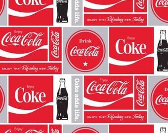 76f4a4d533cb Coca Cola Allover Fleece Fabric - 60