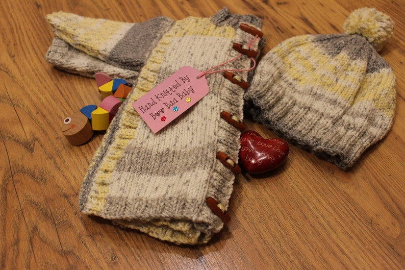 Infants hand knitted coat and hat toggles yellows and greys hand made girls jacket with matching hat cosy knit cardigan set 18-24 months