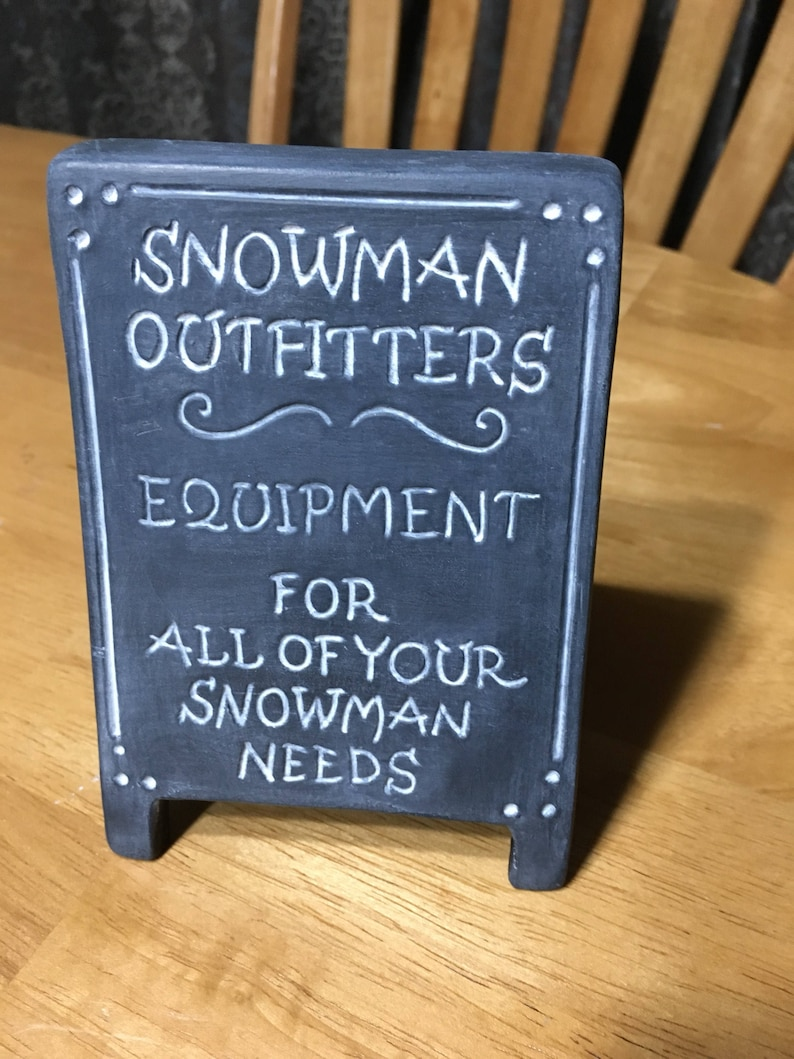 Snowman Outfitters Sign