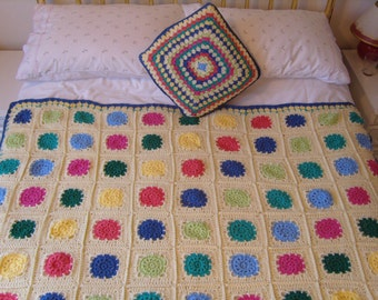 crochet blue and multi coloured throw.
