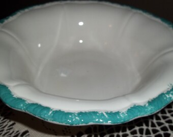 Ironstone with turquoise sponge paint