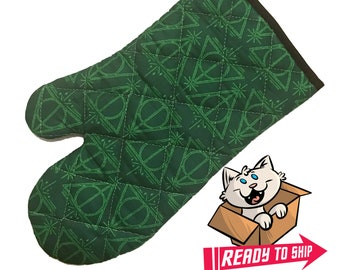 Oven mitt made with green deathly hallows fabric