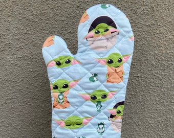 Oven Mitt made with green alien child on blue fabric
