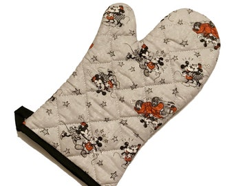 Gray oven mitt made with cartoon mice fabric