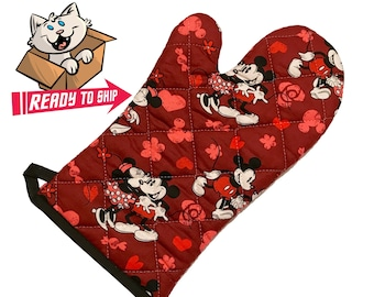 Red oven mitt made with cartoon mice fabric