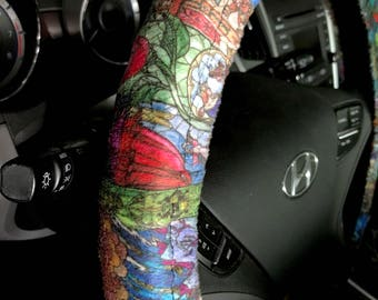 Steering wheel cover made with Beauty and the Beast Stained Glass fabric